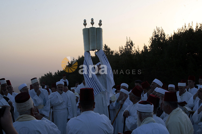 Members of the ancient Samaritan community attend the pilgrimage for the holy day of Passover at the religion's holiest site on the top of Mount Gerizim near the West Bank town of Nablus, early Tuesday, April 30, 2013. According to tradition, the Samaritans are descendants of Jews who were not deported when the Assyrians conquered Israel in the 8th century B.C. Of the small community of close to 700 people, half live in a village at Mount Gerizim, and the rest in the city of Holon near Tel Aviv. Photo by Nedal Eshtayah