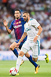 Karim Benzema (r) of Real Madrid fights for the ball with Sergio Busquets Burgos of FC Barcelona  during their Supercopa de Espana Final 2nd Leg match between Real Madrid and FC Barcelona at the Estadio Santiago Bernabeu on 16 August 2017 in Madrid, Spain. Photo by Diego Gonzalez Souto / Power Sport Images