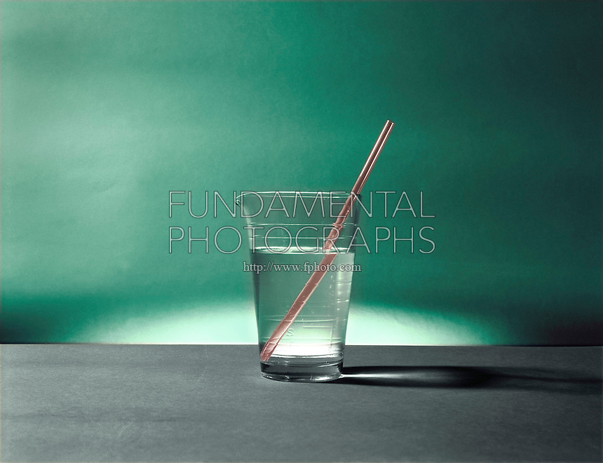 REFRACTION OF LIGHT<br /> Glass Rod in A Beaker Of Water Appears Split<br /> Light rays passing from one medium to another are refracted at the boundary between the two media.