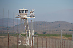 A UN soldier on a watchtower at Quneitra border-crossing in Israel-Syria border, looks through a binocular towards the Syrian side, upon the return of Druze students from their studies at Damascus University in Syria.