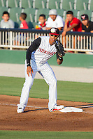 Tyler Williams (6) of the Kannapolis Intimidators waits for a throw at first base during the game against the Greensboro Grasshoppers at CMC-Northeast Stadium on June 14, 2014 in Kannapolis, North Carolina.  The Grasshoppers defeated the Intimidators 4-2.  (Brian Westerholt/Four Seam Images)