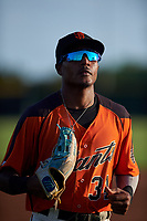 AZL Giants Orange left fielder Javeyan Williams (34) jogs off the field between innings of an Arizona League game against the AZL Mariners on July 18, 2019 at the Giants Baseball Complex in Scottsdale, Arizona. The AZL Giants Orange defeated the AZL Mariners 7-4. (Zachary Lucy/Four Seam Images)