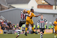 Lenell John-Lewis of Newport County beats Josh Clackstone of Notts County in the air during the Sky Bet League 2 match between Newport County and Notts County at Rodney Parade, Newport, Wales on 6 May 2017. Photo by Mark  Hawkins / PRiME Media Images.