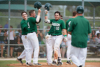 Babson Beavers Edward Lehr (9) congratulates Sean Harrington (10) after a grand slam home run as Thomas Lapham (left) looks on during a game against the Edgewood Eagles on March 18, 2019 at Lee County Player Development Complex in Fort Myers, Florida.  Babson defeated Edgewood 23-7.  (Mike Janes/Four Seam Images)