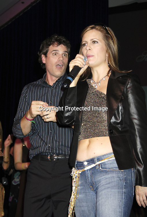 MIchael Park and Martha Byrne singing ..at the 11th Annual Daytime Television Salutes St. Jude Children's Research Hospital benefit hosted by Martha Byrne on October 14, 2005 at The New York Marriott Marquis Hotel. ..Photo by Robin Platzer, Twin Images