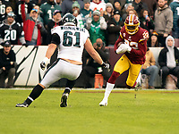 Washington Redskins defensive back Deshazor Everett (22) returns a first quarter interception against the Philadelphia Eagles at FedEx Field in Landover, Maryland on December 30, 2018.  Philadelphia Eagles offensive guard Stefen Wisniewski (61) defends on the play. Photo Credit: Ron Sachs/CNP/AdMedia