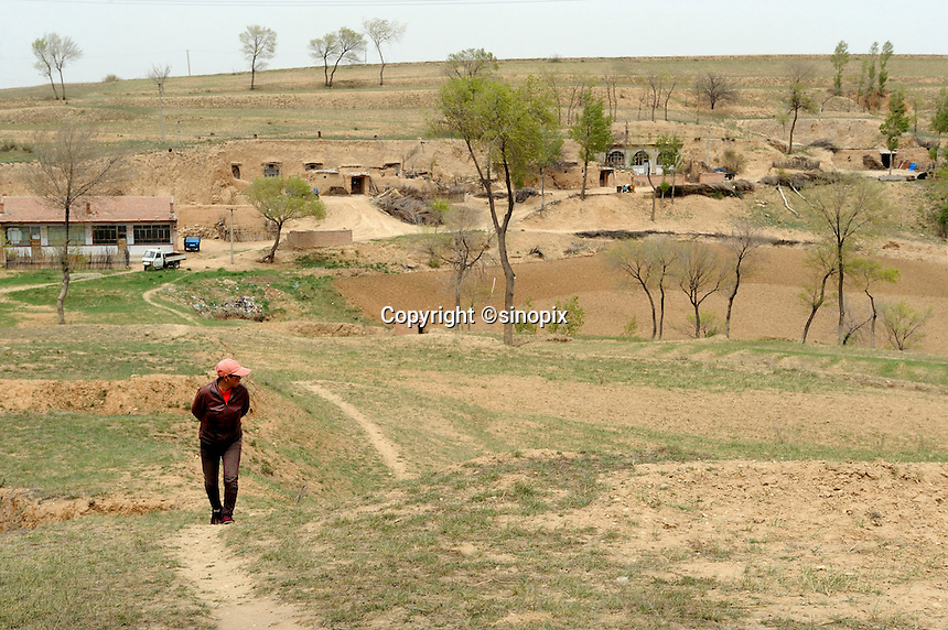Cave dwelling village of Qingshuihe, the National-level Poor county, Hohhot, Inner Mongolia, China.  11-May-2011