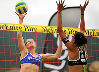 Germany's Okka Rau tries to tip the ball past NZ's Anna Scarlett during the 2009 McEntee Hire NZ Beach Volleyball Tour - Women's final at Oriental Parade, Wellington, New Zealand on Sunday, 11 January 2009. Photo: Dave Lintott / lintottphoto.co.nz.