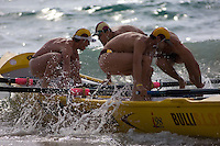 On the starter's gun, the crew jump into the Bulli surf rescue boat at the annual Manly surf carnival.