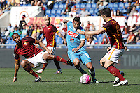Calcio, Serie A: Roma vs Napoli. Roma, stadio Olimpico, 25 aprile 2016.<br /> Napoli&rsquo;s Allan, center, is challenged by Roma&rsquo;s Seydou Keita, left, and Ervin Zukanovic during the Italian Serie A football match between Roma and Napoli at Rome's Olympic stadium, 25 April 2016. <br /> UPDATE IMAGES PRESS/Isabella Bonotto