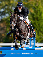 Tatton Winter, with rider Sara Kozumplik (USA), competes during the Stadium Jumping test during the Fair Hill International at Fair Hill Natural Resources Area in Fair Hill, Maryland on October 21, 2012.