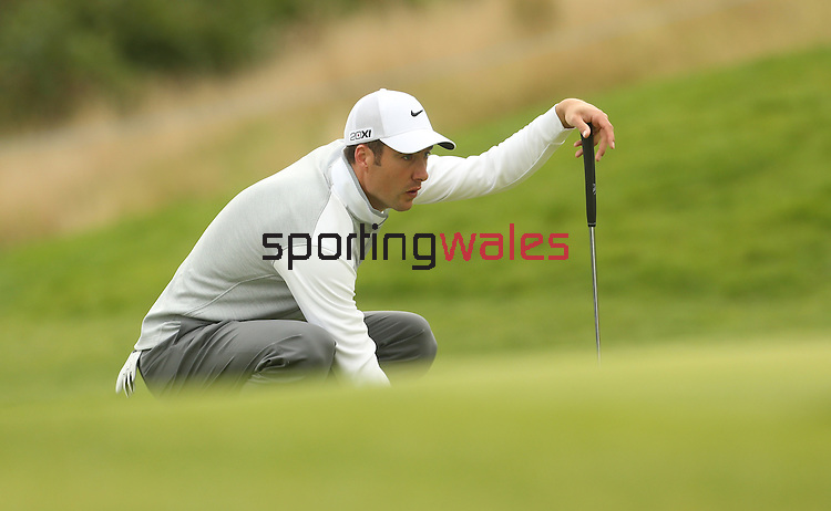 Ross Fisher lines up a birdie putt on the 17th green during the first round of the ISPS Handa Wales Open 2013 at the Celtic Manor Resort<br /> <br /> 29.08.13<br /> <br /> ©Steve Pope-Sportingwales