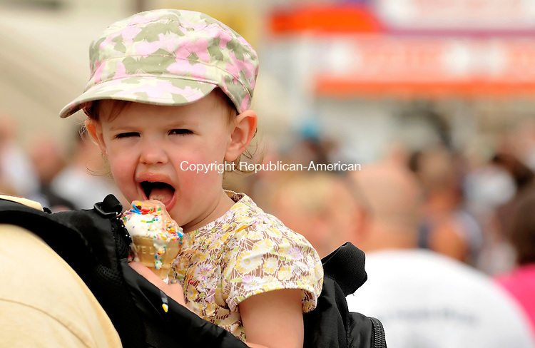 GOSHEN, CT-06 SEPTEMBER 2009-090609JS01-Brooke Gutheil, 2, of Torrington enjoys an ice cream cone while her father Todd Gutheil carries her around during the annual Goshen Fair on Monday. <br /> Jim Shannon Republican-American