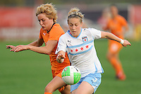 Ella Masar (3) of the Chicago Red Stars and Daphne Koster (4) of Sky Blue FC go for a ball played into space. Sky Blue FC defeated the Chicago Red Stars 1-0 in a Women's Professional Soccer (WPS) match at Yurcak Field in Piscataway, NJ, on April 11, 2010.