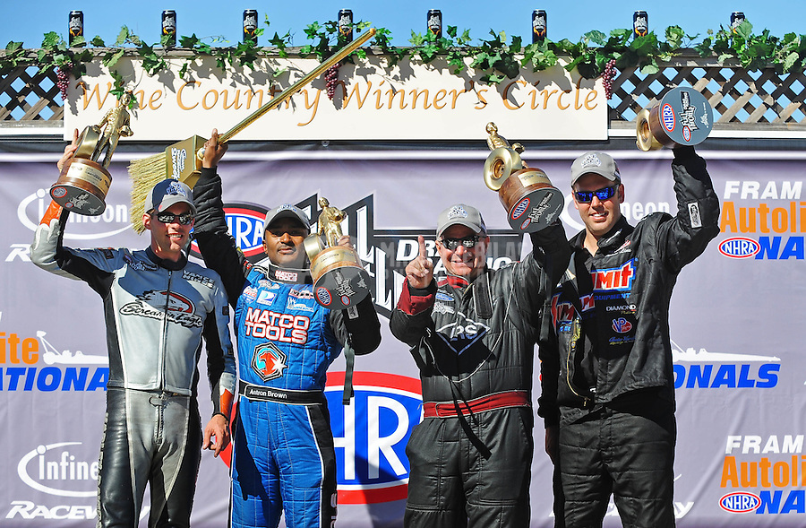 Jul. 26, 2009; Sonoma, CA, USA; NHRA pro class winners (from left) Andrew Hines (pro stock motorcycle) Antron Brown (top fuel) Tim Wilkerson (funny car) and Jason Line (pro stock) celebrates after winning the Fram Autolite Nationals at Infineon Raceway. Mandatory Credit: Mark J. Rebilas-