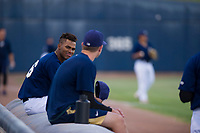 AZL Brewers Ernesto Wilson Martinez (56) talks to a teammate prior to a game against the AZL Cubs at Maryvale Baseball Park in Phoenix, Arizona. AZL Cubs defeated the AZL Brewers 9-1. (Zachary Lucy/Four Seam Images)