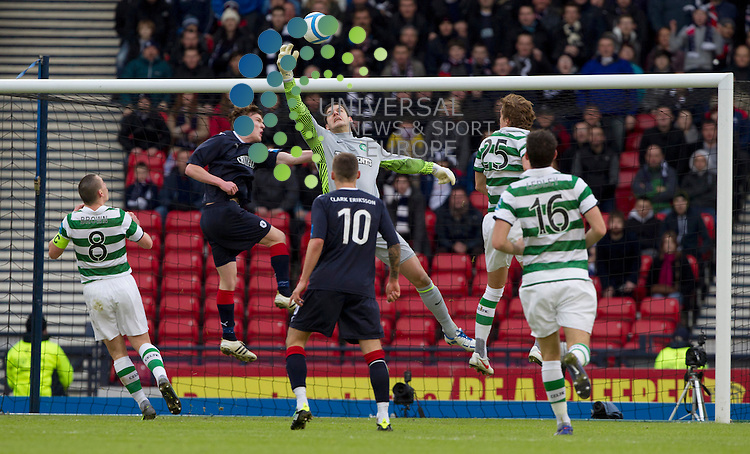 Falkirk push hard at Celtic Keeper Fraser Forster during the Scottish Communities League cup semi - final Falkirk FC v Celtic F.C, at Hampden park..Picture: Maurice McDonald/Universal News And Sport (Scotland). 29 January 2012. www.unpixs.com.