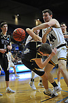 SALEM, VA - MARCH 17: Wisconsin-Oshkosh Titans Jack Flynn C (44) and Nebraska Wesleyan Prairie Wolves guard Nate Bahe (4) fight over a rebound during the Division III Men's Basketball Championship held at the Salem Civic Center on March 17, 2018 in Salem, Virginia. Nebraska Wesleyen defeated Wisconsin-Oshkosh 78-72 for the national title. (Photo by Andres Alonso/NCAA Photos/NCAA Photos via Getty Images)