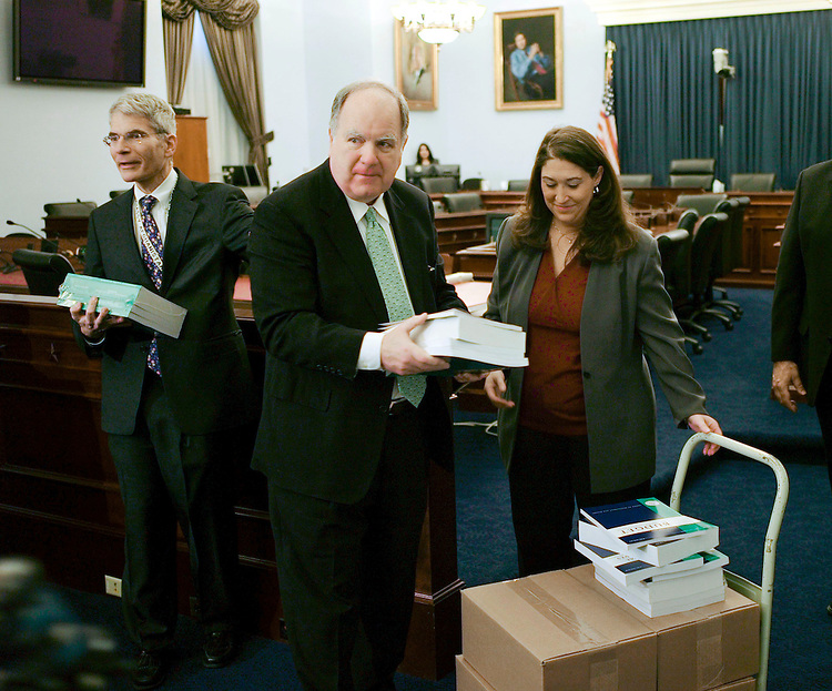 WASHINGTON, DC - Feb 04: House Budget Chairman John M. Spratt Jr., D-S.C., receives copies of President Bush's fiscal 2009 budget request from Government Printing Office Chief of Staff Maria S. Lefevre during a photo op in the House Budget Committee meeting room. House Budget Staff Director and Chief Counsel Thomas S. Kahn looks on at left. The $3.1 trillion fiscal 2009 budget proposal, released today, represents Bush's last chance to put his imprint of the nation's fiscal landscape. But with Democrats controlling Congress and hoping to win the presidency in November, Bush's budget has little chance of being enacted. (Photo by Scott J. Ferrell/Congressional Quarterly)