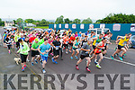The runners take off at  the start of  the Humphrey Kelleher memorial 5k in Castleisland on Friday evening