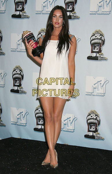 MEGAN FOX.2008 MTV Movie Awards held at Gibson Amphitheatre, Universal City, California, USA, 01 June 2008..awards room full length red lipstick white silver straps dress award trophy tattoos gold Christian Louboutin shoes.CAP/ADM/MJ.©Michael Jade/Admedia/Capital Pictures