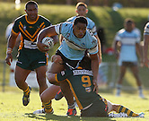 Junior Moors of the Cronulla Sharks, looks to try and get out of a tackle by Mitch Williams of the  Wyong Roosduring Round 5 of the 2013 NSW Cup at Morrie Breen Oval on April 7, 2013 in Wyong, Australia. (Photo by Paul Barkley/LookPro)