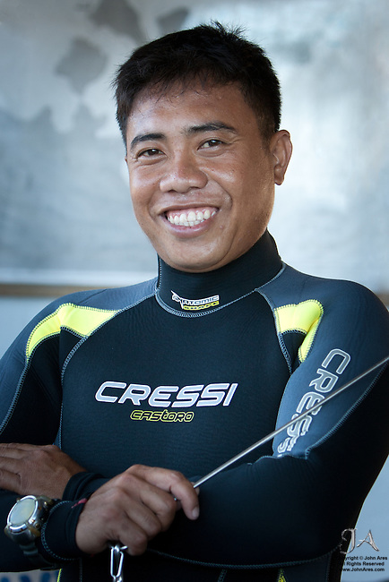 "We spent most of our diving with Bala.  He was a superb Divemaster that was an expert ""finder.""   Bala is holding his ""critter pointer,"" a tool used to gently point out delicate and small creatures of the reef."