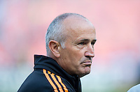 Houston Dynamo head coach Dominic Kinnear watches his team during a Major League Soccer game at RFK Stadium in Washington, DC. D.C. United vs. Houston Dynamo, 2-1.
