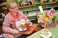 "Michael McCollum.3/15/13.Co-owner (with her husband) Marcella Giunti serves ""orange"" juice (red and delicious) coffee and cappuccino in Pasticceria Armando e Marcella in the town of San Gimignano, Tuscany, Italy.."
