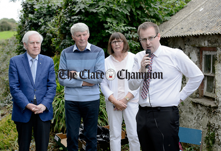 Historian Steven Mc Donagh speaking, watched by Labhrás Ó Murchú, Director-General of Comhaltas Ceoltóirí Éireann and Patrick and Mary Malone at the unveiling of a memorial at the house where the blind piper Patrick O Brien was born at Labasheeda. Photograph by John Kelly.