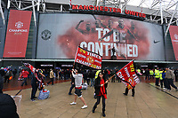 """Pictured: A young man and woman holding a """"20 Times Champions"""" flag outside the ground before kick off. Sunday 12 May 2013<br /> Re: Barclay's Premier League, Manchester City FC v Swansea City FC at the Old Trafford Stadium, Manchester."""