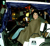 Actress Elizabeth Taylor drives a golf cart at the head of the National AIDS Candle Light March from the Capitol to the Lincoln Memorial in Washington, D.C. on October 12, 1996..Credit: Ron Sachs / CNP
