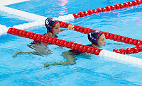 30 JUL 2012 - LONDON, GBR - Courtney Mathewson (right) and Maggie Steffens (left) of the USA wait to play again during the London 2012 Olympic Games preliminary round water polo match against Hungary at the Olympic Park, Stratford, London, Great Britain .(PHOTO (C) 2012 NIGEL FARROW)