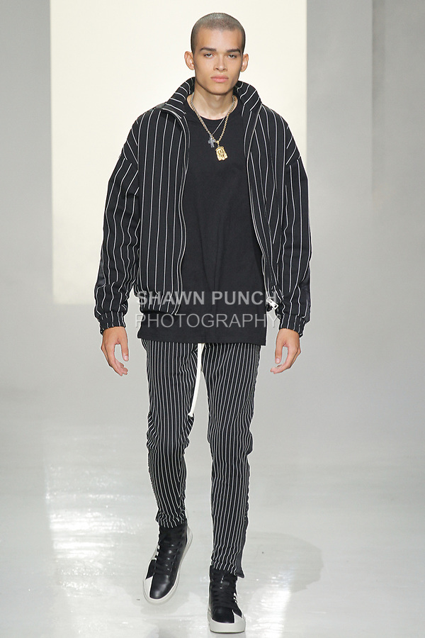 """Model walks runway in an outfit from the Represent Clo Spring Summer 2018 """"Wide Awake"""" collection, at Skylight Clarkson Square on July 13, 2017; during New York Fashion Week: Men's Spring Summer 2018."""