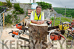 SHIVER ME TIMBERS:  Kilgarvan's Eamon Horgan with his collection of mean teethed saws gives an exhibition in how to cut down and saw up a tree at the Kilgarvan Vintage Day and Traditional Music Festival.