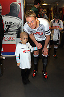 ATTENTION SPORTS PICTURE DESK<br /> Pictured: Children mascots Lucy Wiemens (L) with captain Garry Monk before the game.<br /> Re: Coca Cola Championship, Swansea City Football Club v Scunthorpe United at the Liberty Stadium, Swansea, south Wales. Saturday 05 April 2010