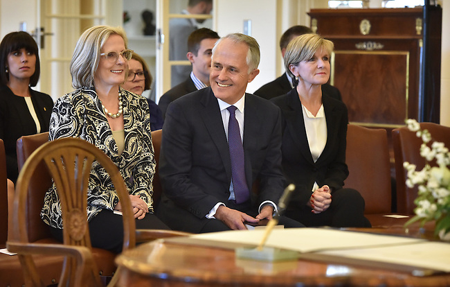 Australian Prime Minister Malcolm Turnbull (C) sits with his wife Lucy (L) and Foreign Minister Julie Bishop (R) at Government House, Canberra on September 15, 2015. Photographer: Mark Graham/Bloomberg
