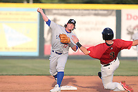 Wade Kirkland #12 of the Stockton Ports throws to first base after forcing out Brandon Drury #3 of the Visalia Rawhide at second base  during a game at Rawhide Ballpark on May 5, 2014 in Visalia California. Visalia defeated Stockton, 8-6. (Larry Goren/Four Seam Images)