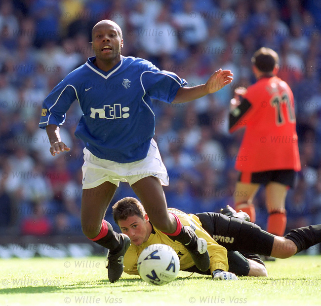 Rod Wallace sent sprawling by Alan Comce, Rangers v Dundee Utd 1999