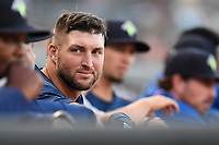 Designated hitter Tim Tebow (15) of the Columbia Fireflies watches with the coaches during a game against the Lexington Legends on Thursday, June 8, 2017, at Spirit Communications Park in Columbia, South Carolina. Columbia won, 8-0. (Tom Priddy/Four Seam Images)