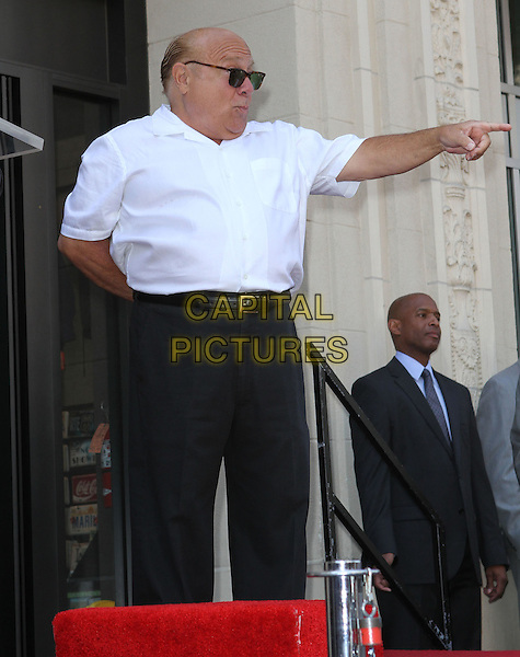 Danny DeVito.Danny DeVito Honored On The Hollywood Walk Of Fame Held On Hollywood Blvd., Hollywood, California, USA..August 18th, 2011.full length white shirt sunglasses shades black trousers arm hand pointing profile .CAP/ADM/KB.©Kevan Brooks/AdMedia/Capital Pictures.