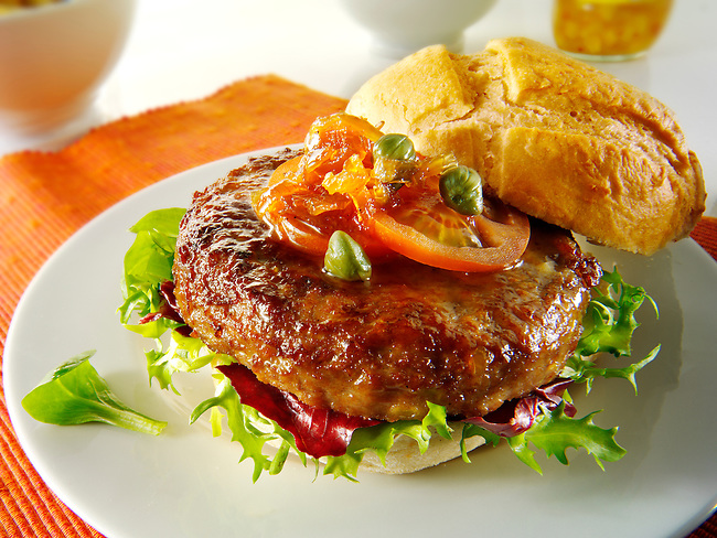 Beef burgers in a bread bun with salad & garnish