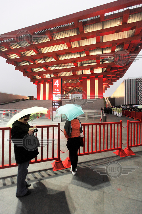 Visitors looking at the China Pavilion during the first day of the trial run for the 2010 World Expo.