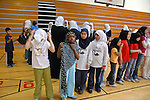 """Runners take their places at the start of the women's track and field events at the Islamic Games in South Brunswick, New Jersey on May 26, 2007.  The event website promised that """"If you can pray in it, you can play in it""""; over 600 youths from five states participated in the event."""