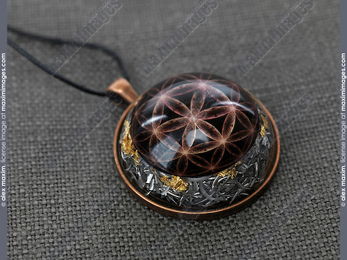 Orgonite necklace spiritual healing stone with the flower of life design