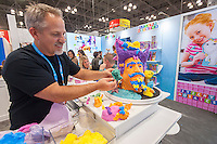 Master sculptor Jon Neill creates sculptures using Morph at the Orb booth in the 114th North American International Toy Fair in the Jacob Javits Convention center in New York on Sunday, February 19, 2017.  The four day trade show with over 1000 exhibitors connects buyers and sellers and draws tens of thousands of attendees.  The toy industry generates over $26 billion in the U.S. alone and Toy Fair is the largest toy trade show in the Western Hemisphere. (© Richard B. Levine)
