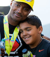 Jun 7, 2015; Englishtown, NJ, USA; NHRA top fuel driver Antron Brown (left) celebrates with son Anson Brown after winning the Summernationals at Old Bridge Township Raceway Park. Mandatory Credit: Mark J. Rebilas-