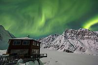 Aurora Borealis (Northern Lights) and Sheldon Chalet in the Alaska Range in the Don Sheldon Amphitheater