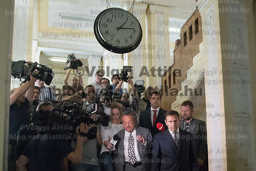 Tamas Gyarfas (C) vice-president of FINA swimming association and his lawyer Janos Banati (L) leave after a court ruling connected to his arrest in a murder case in Budapest, Hungary on April 20, 2018. ATTILA VOLGYI