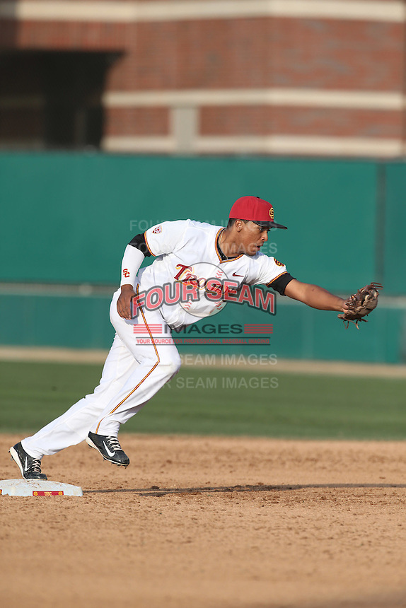 Dante Flores (3) of the Southern California Trojans during a game against the Oakland Grizzlies at Dedeaux Field on February 21, 2015 in Los Angeles, California. Southern California defeated Oakland, 11-1. (Larry Goren/Four Seam Images)